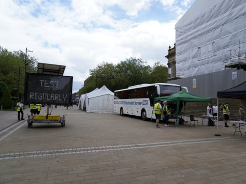 A mobile Covid-19 vaccination centre outside Bolton Town Hall (Peter Byrne/PA)
