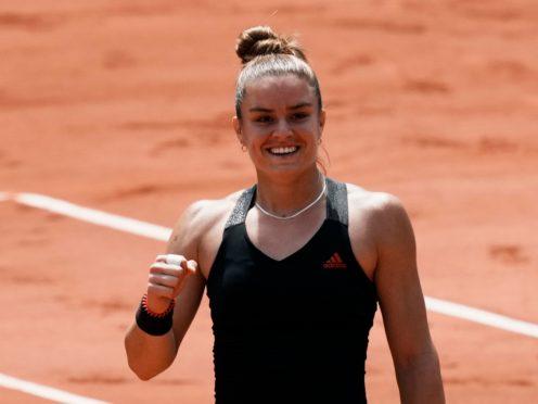 Maria Sakkari celebrates victory over Iga Swiatek (Thibault Camus/AP)