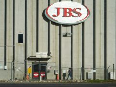 A worker heads into the JBS meatpacking plant in Greeley, Colorado. The world's largest meat processing company says it paid the equivalent of 11 million dollars to hackers who broke into its computer system late last month (David Zalubowski/AP)