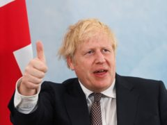 Prime Minister Boris Johnson gives a thumbs up gesture (Toby Melville/PA)