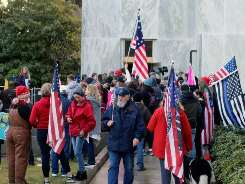 Pro-Trump and anti-mask demonstrators hold a rally outside the Oregon State Capitol last December. A Republican politician has been expelled from the legislature for letting some of the protesters in (Andrew Selsky/AP)