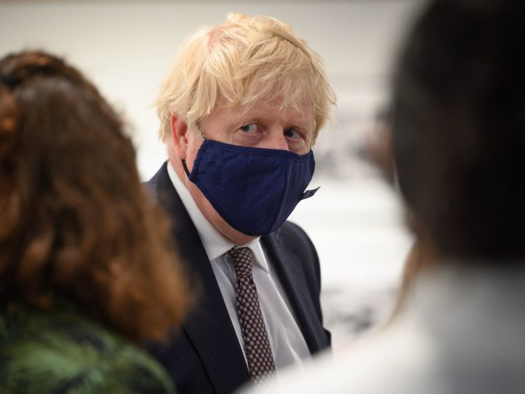 Boris Johnson plans to amount spent on foreign aid (Leon Neal/PA)