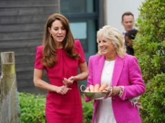 The Duchess of Cambridge (left) and US First Lady Jill Biden, carrying carrots for the school rabbit, Storm (Aaron Chown/PA)