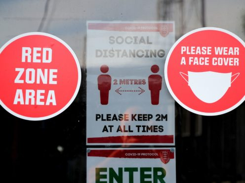 Social distancing signage (Richard Sellers/PA)