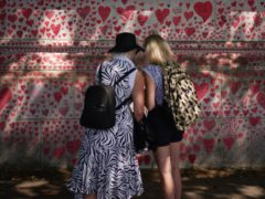 The Covid memorial wall on the Embankment in London (Yui Mok/PA)