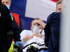 Christian Eriksen leaves the field after collapsing (Friedemann Vogel/Pool via AP)