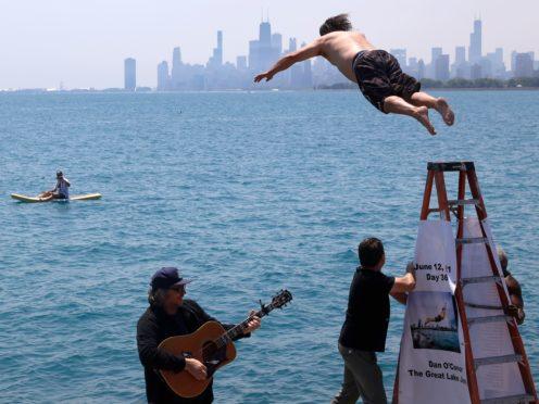 Dan O'Conor makes his 365th leap into Lake Michigan (Shafkat Anowar/AP)