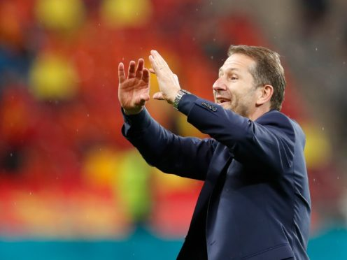 Austria boss Franco Foda celebrates his side's victory (Robert Ghement/AP).