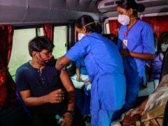 A health worker administers a Covid-19 vaccine in Kolkata, India (Bikas Das/AP)
