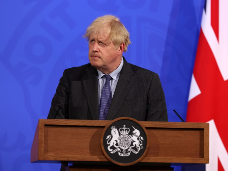 Prime Minister Boris Johnson has moved back easing restrictions by four weeks (Jonathan Buckmaster/Daily Express/PA)