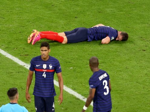 French medical officials say Benjamin Pavard, top, did not lose consciousness or suffer a concussion after his collision with Germany's Robin Gosens on Tuesday (Alexander Hassenstein/AP)