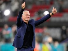 Didier Deschamps salutes the French fans after his side's opening group win in Munich against Germany (Matthias Schrader/AP Pool)