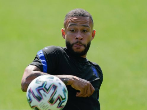 Memphis Depay is expected to sign for Barcelona (Peter Dejong/AP)