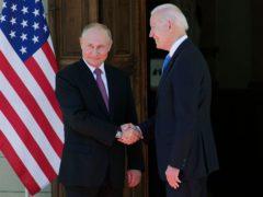 Russian president Vladimir Putin, left, and US president Joe Biden shake hands ahead of their summit (Alexander Zemlianichenko, Pool/AP)