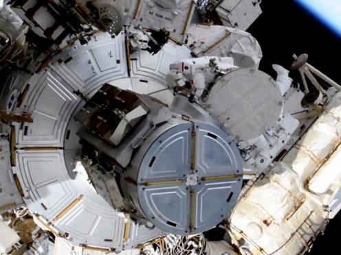 French astronaut Thomas Pesquet, top centre, ventures out on a spacewalk (NASA via AP)