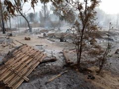 Smoke rises from smouldering houses in Kinma village in central Myanmar (AP)