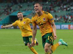 Connor Roberts (right) celebrates scoring for Wales against Turkey in Baku on Wednesday (Tolga Bozoglu/AP)