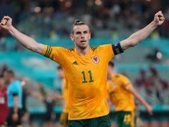 Gareth Bale celebrates at the end of Wales' 2-0 victory over Turkey at Euro 2020 (Darko Vojinovic/AP)