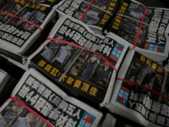 Copies of the Apple Daily newspaper (AP/Kin Cheung)