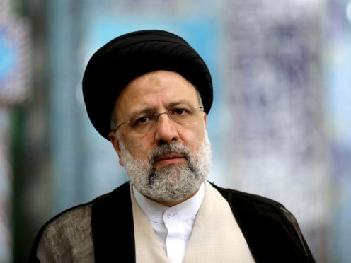Ebrahim Raisi casts his vote at a polling station in Tehran (Ebrahim Noroozi/AP)