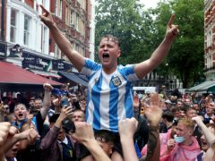 Scotland fans gather in Leicester Square before the Euro 2020 match between England and Scotland (PA)