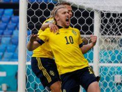 Emil Forsberg celebrates his winning goal (Anatoly Maltsev/AP)