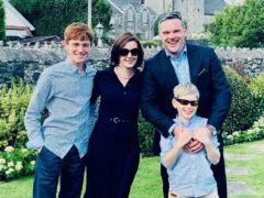 Mathew O'Toole with his wife Georgina and their two children (Mathew O'Toole/PA)