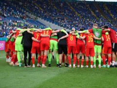Wales reflect on their progress to the last 16 at Euro 2020 in a post-match huddle after their defeat to Italy (Riccardo Antimiani, Pool via AP)