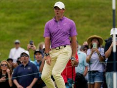 Rory McIlroy reacts after missing a putt on the fifth green during the final round of the US Open (Gregory Bull/AP)