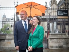 Sarah Green is welcomed to the House of Commons by Sir Ed Davey (Stefan Rousseau/PA)
