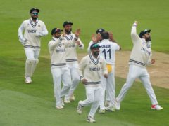 India's players celebrate the wicket of New Zealand's Ross Taylor (Adam Davy/PA)