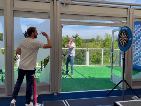 Gareth Southgate plays darts at the England media centre (Simon Peach/PA)