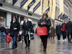 The Scottish Government is consulting on whether larger stores should be forced to shut on New Year's Day (John Linton/PA)