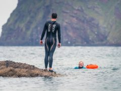 Wild swimmers in Cullykhan bay, Aberdeenshire (VisitScotland/PA)
