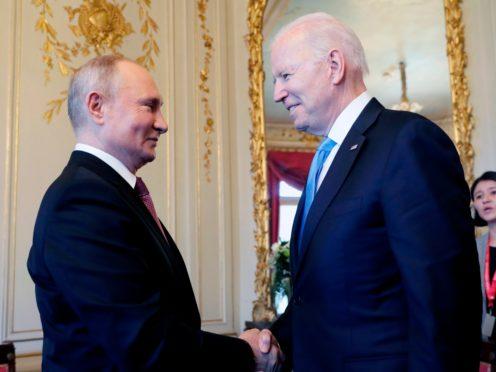 US president Joe Biden, right, and Russian president Vladimir Putin, shake hands during their meeting in Switzerland (Mikhail Metzel/Pool Photo via AP)