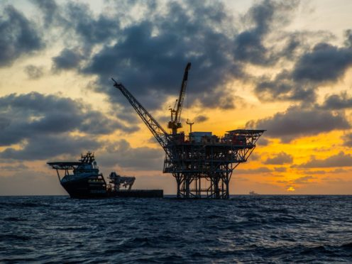 The FTSE climbed higher after a surge in oil prices helped BP and Shell (BP/PA)