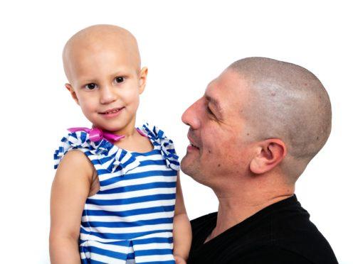 Aaron Lambert, 36, with his daughter Esme (Wendy Lambert/ PA)