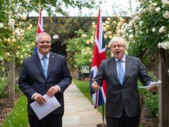 Prime Minister Boris Johnson (right) announced details of the new trade deal with Australian prime minister Scott Morrison (Dominic Lipinski/PA)