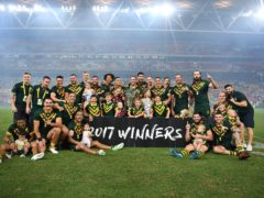 Handout photo provided by NRL Imagery of Australia posing with the trophy after the final of the 2017 Rugby League World Cup at the Suncorp Stadium, Brisbane