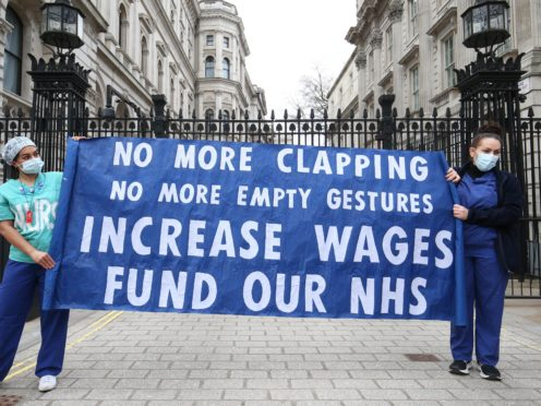 Nurses and NHS workers from the campaign group NHS Workers Say No, and Unite's Guys and St Thomas Hospital Union branch, hold a socially distanced protest outside Downing Street (Jonathan Brady/PA)