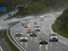 Seven in 10 drivers want lower motorway speed limits in wet weather, a new survey suggests (Steve Parsons/PA)