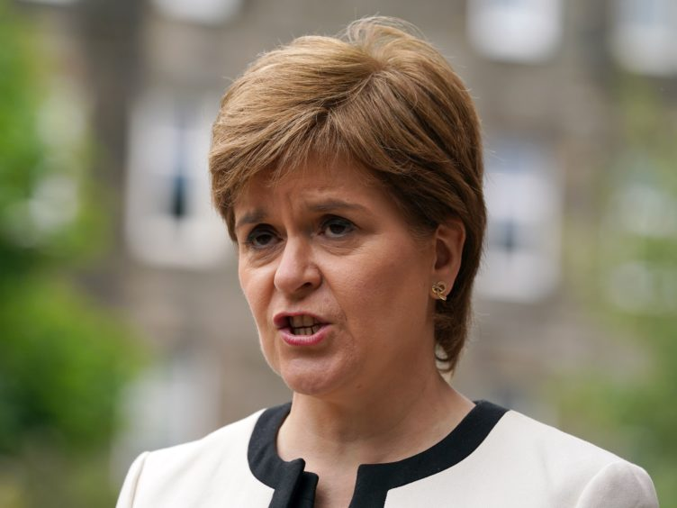 Nicola Sturgeon accused opposition parties of being 'childish' for saying her government missed the vaccine target (Andrew Milligan/PA)