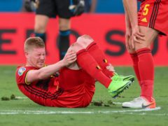 Belgium's Kevin De Bruyne reacts during the Euro 2020 soccer championship round of 16 match between Belgium and Portugal at La Cartuja stadium, Seville, Spain, Sunday, June 27, 2021. (Lluis Gene/Pool Photo via AP)