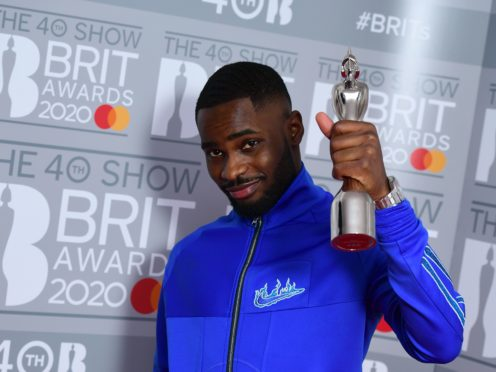 Dave with the Brit Award for best British album (Ian West/PA)