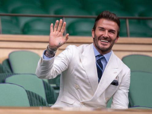 David Beckham waves to the crowd (Ben Solomon/AELTC Pool/PA)