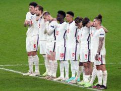 England's Jadon Sancho and Bukayo Saka alongside team mates during the penalty shootout (Mike Egerton/PA)