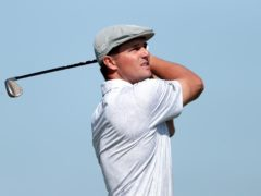 Bryson DeChambeau was out on the course early on Saturday (Alastair Grant/AP)