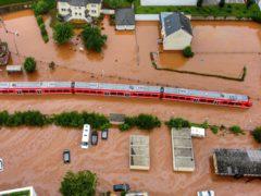 A regional train sits in flood waters at the local station in Kordel, Germany (Sebastian Schmitt/dpa via AP)