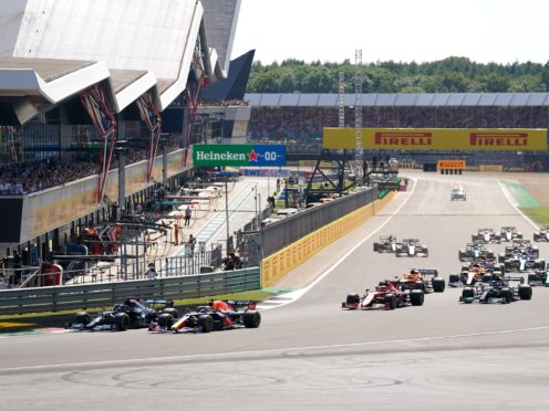 Mercedes' Lewis Hamilton and Red Bull Racing's Max Verstappen lead the race at the start of the race during the British Grand Prix at Silverstone, Towcester. Picture Date: Sunday July 18, 2021.