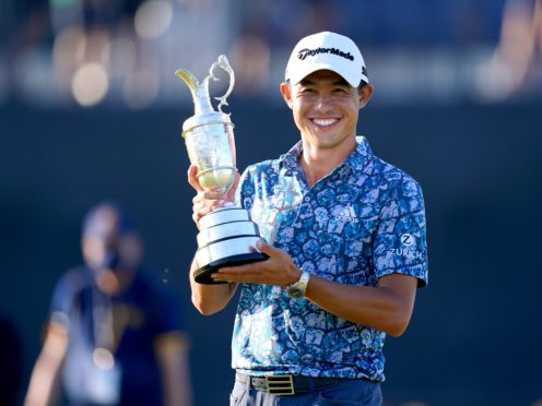 Collin Morikawa celebrates with the Claret Jug after winning the 149th Open (Gareth Fuller/PA)